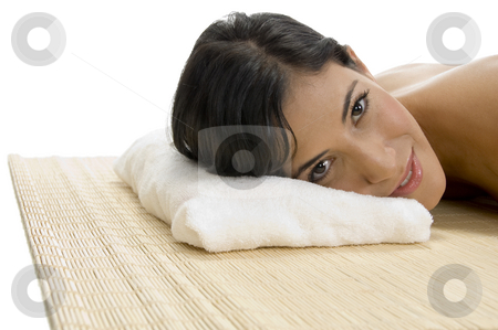 Laying woman looking to camera stock photo, Laying woman looking to camera on an isolated background by Imagery Majestic