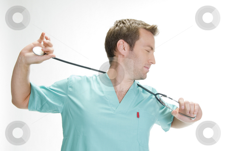 American doctor holding his stethoscope stock photo, American doctor holding his stethoscope by Imagery Majestic