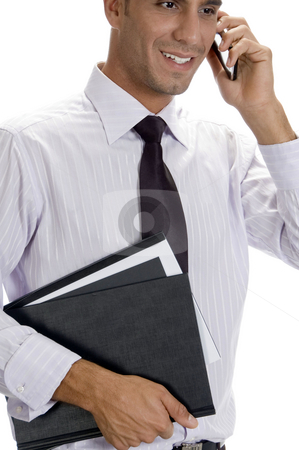 Successful businessman busy on phone call stock photo, Successful businessman busy on phone call on an isolated white background by Imagery Majestic