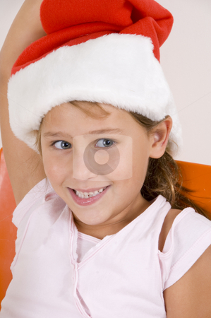 Smiling little girl with christmas hat stock photo, Smiling little girl with christmas hat by Imagery Majestic