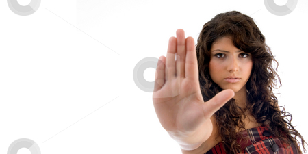 Beautiful woman showing stopping gesture stock photo, Beautiful woman showing stopping gesture on an isolated background by Imagery Majestic