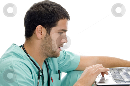 Doctor with laptop looking you stock photo, Doctor with laptop looking you against white background by Imagery Majestic