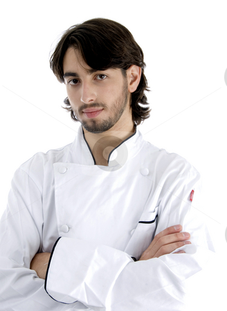 Young chef posing with his arms crossed stock photo, Young chef posing with his arms crossed isolated on white background by Imagery Majestic