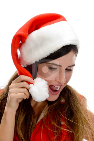 Woman with santa cap and looking downward stock photo, Woman with santa cap and looking downward on an isolated white background by Imagery Majestic