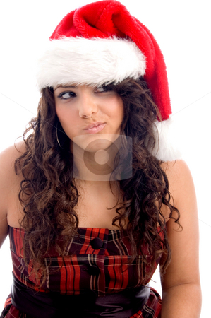 Woman with christmas hat making face stock photo, Woman with christmas hat making face against white background by Imagery Majestic