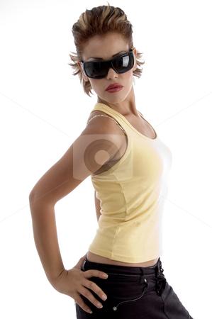 Sexy woman wearing sunglasses  stock photo, Sexy woman wearing sunglasses on an isolated white background by Imagery Majestic