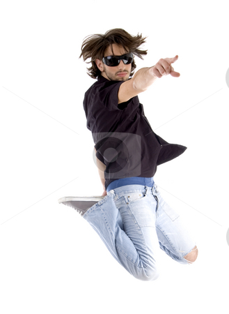 Jumping handsome man pointing you stock photo, Jumping handsome man pointing you with white background by Imagery Majestic