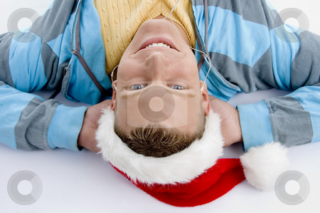 Laying smiling man with christmas hat stock photo, Laying smiling man with christmas hat on an isolated white background by Imagery Majestic