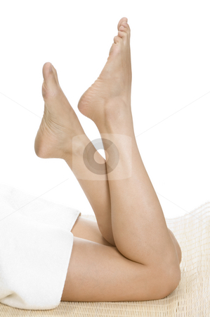 Beautiful legs of female stock photo, Beautiful legs of female on an isolated white background by Imagery Majestic