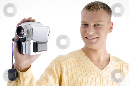 Portrait of blonde man with handy cam stock photo, Portrait of blonde man with handy cam on an isolated white background by Imagery Majestic