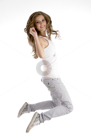 Jumping female dancer stock photo, Jumping female dancer on an isolated white background by Imagery Majestic