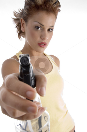 Woman posing with spray bottle stock photo, Woman posing with spray bottle against white background by Imagery Majestic