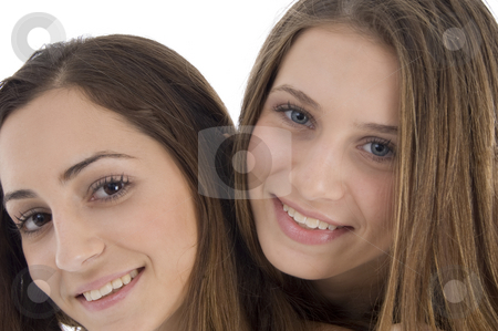 Close up of young female friends stock photo, Close up of young female friends isolated with white background by Imagery Majestic