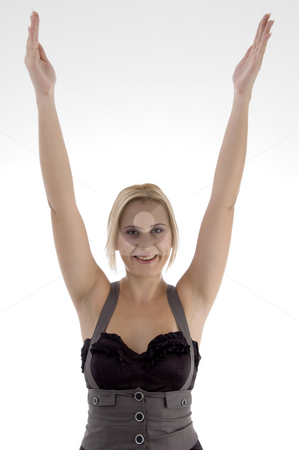 Smiling woman stretching her arms stock photo, Smiling woman stretching her arms against white background by Imagery Majestic