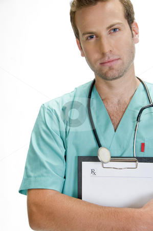 Handsome doctor with stethoscope holding writing pad stock photo, Handsome doctor with stethoscope holding writing pad by Imagery Majestic