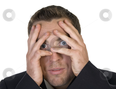 Businessman peeking behind his hand stock photo, Businessman peeking behind his hand against white background by Imagery Majestic