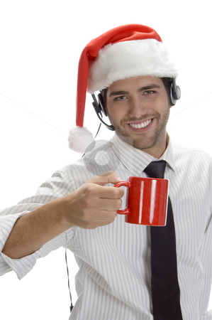 Young man enjoying coffee and wearing santa cap stock photo, Young man enjoying coffee and wearing santa cap isolated on white background by Imagery Majestic