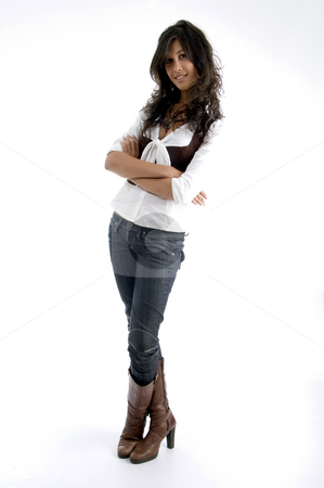Young model posing with her arms crossed stock photo, Young model posing with her arms crossed on an isolated white background by Imagery Majestic