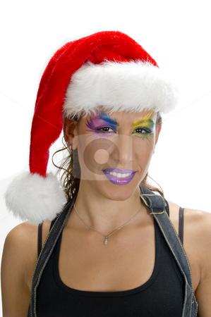 Female in christmas cap stock photo, Portrait of female in christmas cap by Imagery Majestic