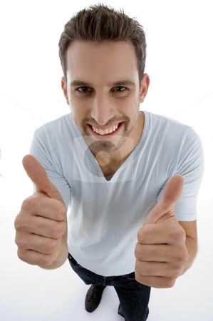 Young man showing thumbs up gesture stock photo, Young man showing thumbs up gesture on an isolated white backgound by Imagery Majestic