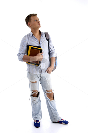 Full body pose of student holding his books stock photo, Full body pose of student holding his books with white background by Imagery Majestic