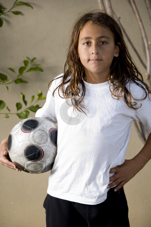 Tired boy with soccer ball stock photo, Tired boy standing with soccer ball by Imagery Majestic