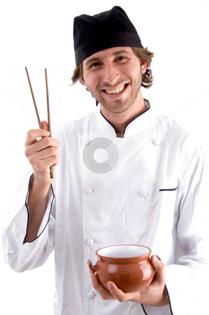 Happy chef holding bowl and chopsticks stock photo, Happy chef holding bowl and chopsticks on an isolated background by Imagery Majestic