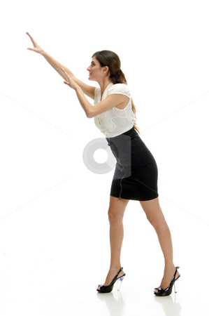 Dancing young woman stock photo, Dancing young woman on an isolated white background by Imagery Majestic
