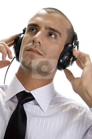 Smart businessman with headphone stock photo, Smart businessman with headphone on an isolated background by Imagery Majestic