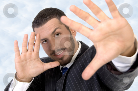 Executive giving directing hand gesture stock photo, Executive giving directing hand gesture against white background by Imagery Majestic