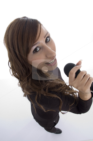 Model singing in microphone stock photo, Model singing in microphone with white background by Imagery Majestic
