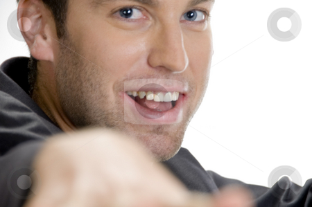 Happy man looking at camera stock photo, Happy man looking at camera against white background by Imagery Majestic