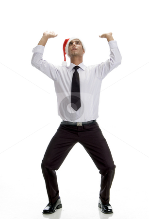 Young businessman looking upward stock photo, Young businessman looking upward against white background by Imagery Majestic