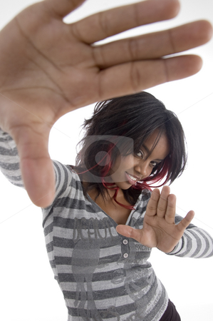 Girl showing her hands stock photo, Girl showing her hands against white background by Imagery Majestic