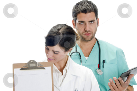 Medical professionals with paper in writing board stock photo, Medical professionals with paper in writing board against white background by Imagery Majestic