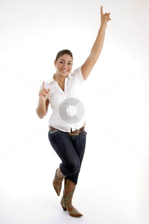 Standing model indicating upward stock photo, Standing model indicating upward on an isolated background by Imagery Majestic