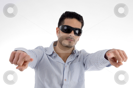Pointing male with sunglasses stock photo, Pointing male with sunglasses against white background by Imagery Majestic
