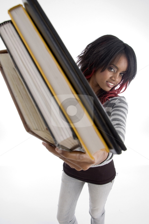 Girl showing books stock photo, Girl showing books against white background by Imagery Majestic