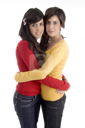 Hugging young friends stock photo, Hugging young friends with white background by Imagery Majestic