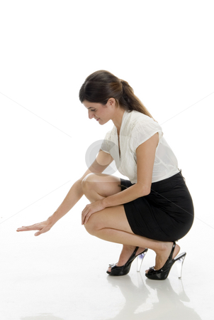 Sitting lady looking down side stock photo, Sitting lady looking down side on an isolated white background by Imagery Majestic