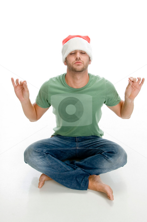 Man doing meditation stock photo, Man doing meditation on an isolated background by Imagery Majestic