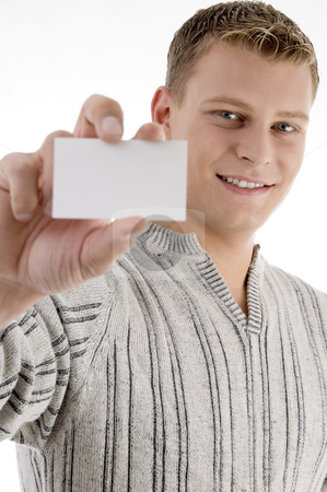 Smiling man showing business card stock photo, Smiling man showing business card with white background by Imagery Majestic