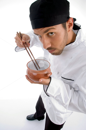 Chef with chopsticks and bowl stock photo, Chef with chopsticks and bowl with white background by Imagery Majestic