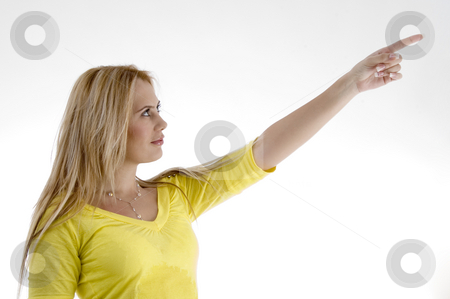 Smiling woman pointing side stock photo, Smiling woman pointing side on an isolated white background by Imagery Majestic