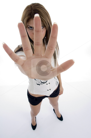 Standing female showing her fingers stock photo, Standing female showing her fingers on an isolated background by Imagery Majestic