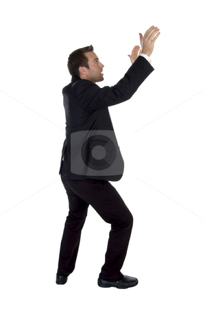 Side view of success businessman with raised hands stock photo, Side view of success businessman with raised hands on white background by Imagery Majestic