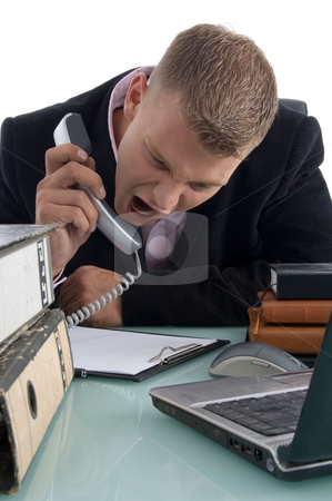 Executive shouting on phone stock photo, Executive shouting on phone on an isolated background by Imagery Majestic