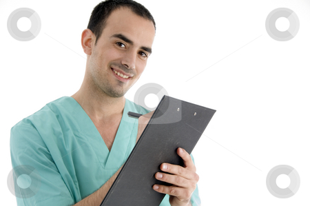 Doctor writing on notepad stock photo, Doctor writing on notepad on an isolated white background by Imagery Majestic