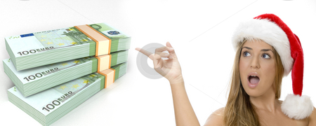 Three dimensional bundles of euro money and woman with santa hat  stock photo, Three dimensional bundles of euro money and woman with santa hat on an isolated white background by Imagery Majestic