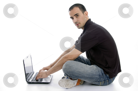Man with laptop stock photo, Man with laptop with white background by Imagery Majestic